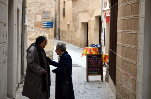 Two ladies conversing outside a tapas bar