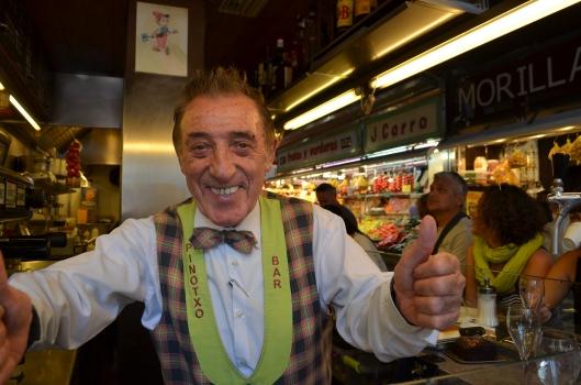 Juan Bayen, owner of Bar Pinotxo giving us his signature thumbs up in Mercat De La Boqueria, Barcelona